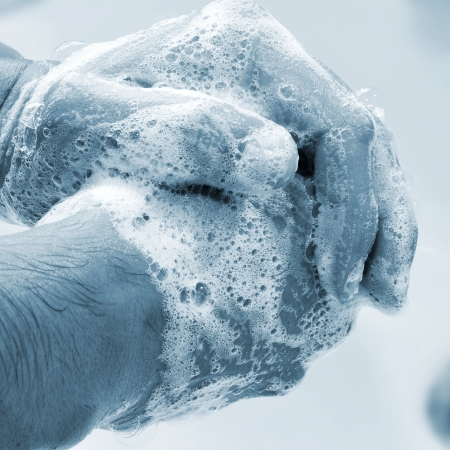 foam hand: a man washing his hands with soap Stock Photo