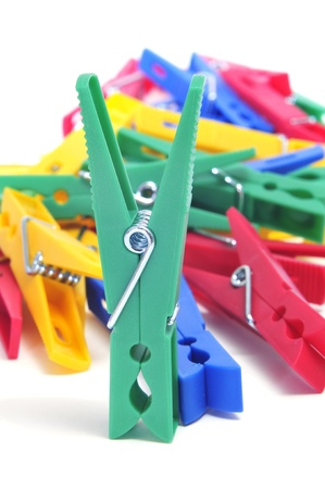 clothes peg: a pile of clothespins of different colors on a white background