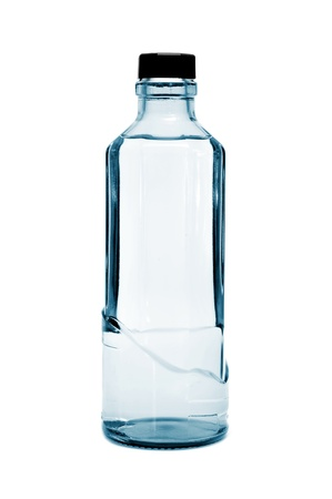 thirstiness: a glass bottle of water on a white background Stock Photo