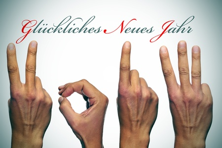 0 1 year: gl�ckliches neues jahr, happy new year written in german, with hands forming number 2013