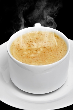 cortado: closeup of a cup with caffe latte on a black background