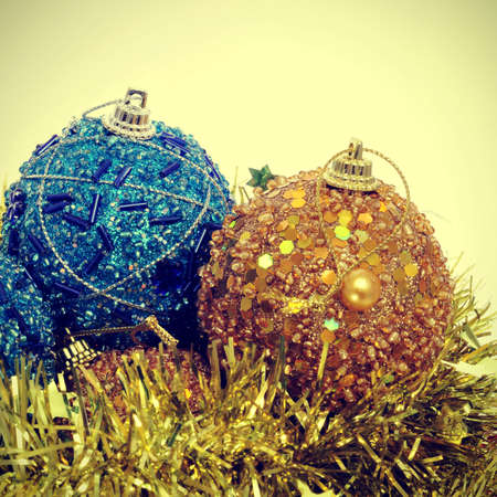 x mas: some christmas balls and golden tinsel with a retro effect