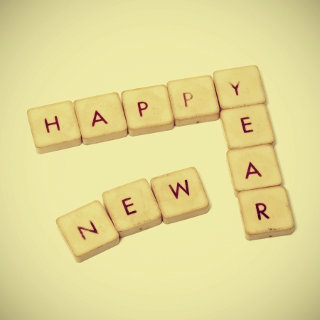 happy new year written with tiles of a word game with a retro effect photo