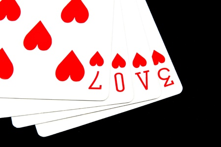 word love written with heart pips playing cards photo