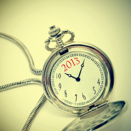 number 2013, the new year, written in a pocket watch, with a retro effect Stock Photo - 16169895