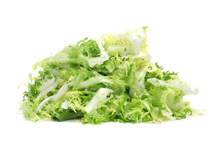escarole: some chopped leaves of escarole endive on a white background