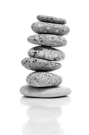 a stack of balanced zen stones on a white background Stock Photo - 16169892