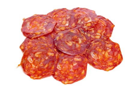 some slices of red spanish chorizo on a white background Stock Photo - 16170114