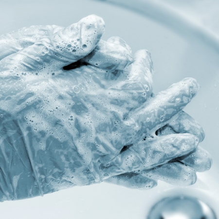 someone wearing surgical gloves washing his hands Stock Photo - 16262698