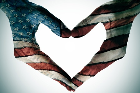 july: man hands painted as the american flag forming a heart