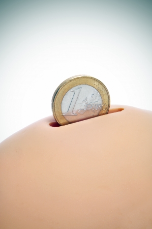 thrift box: closeup of one euro coin in a piggy bank Stock Photo