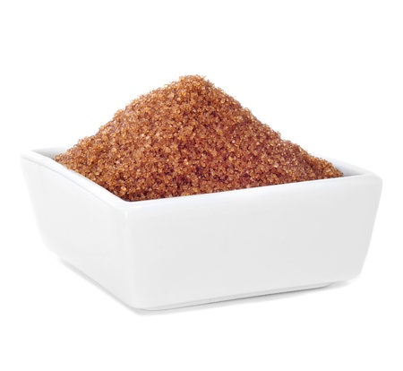 a white bowl with brown sugar on a white background photo
