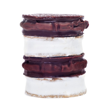 alfajores: some argentinean-uruguayan alfajores with different flavors on a white background