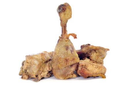 some pieces of roasted chicken on a white background photo