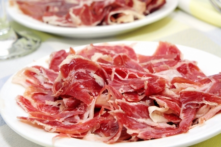 jamon: closeup of some plates with spanish serrano ham served as tapas