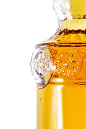 thirstiness: closeup of a bottle of dessert wine on a white background