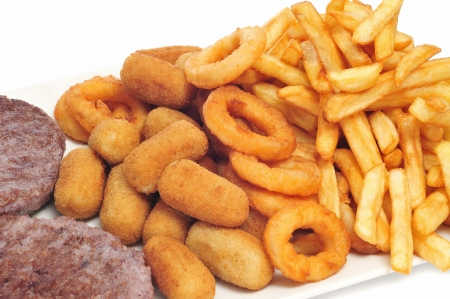 croquettes: tray with fattening food, such as burgers, croquettes, calamares and french fries Stock Photo