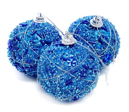 some blue christmas balls on white background photo