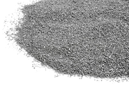 litter: closeup of a pile of gray gravel on a white background