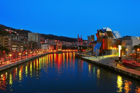 Bilbao, Spain - November 14, 2012: Estuary and Guggenheim Museum at night in Bilbao, Spain. The picturesque museum was designed by Frank Ghery