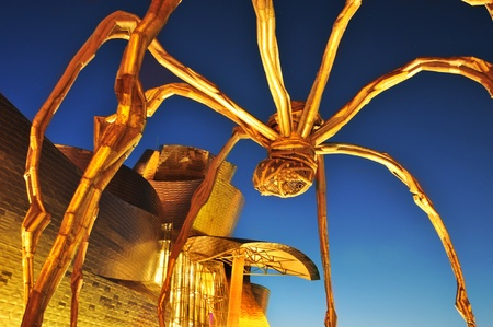 Bilbao, Spain - November 14, 2012: Guggenheim Museum and Maman sculpture in Bilbao, Spain. The museum was designed by Frank Ghery and the sculpture, a giant spider, by Louise Bourgeois Stock Photo - 16463264