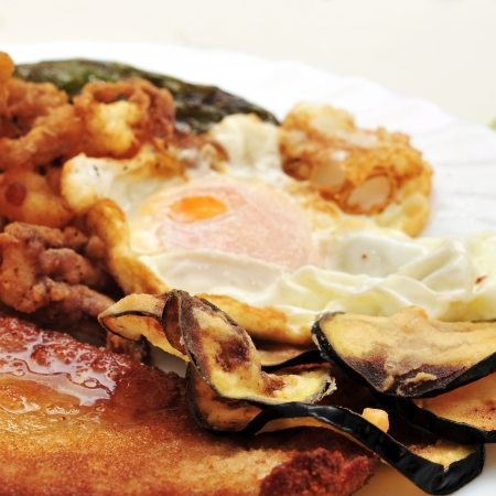 combo platter with fried eggs, breaded chicken, battered eggplant and grilled pepper Stock Photo - 16520356
