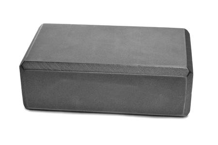 a gray yoga foam block on a white background Stock Photo - 16520359