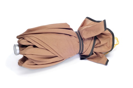 impermeable: folded brown umbrella on a white background