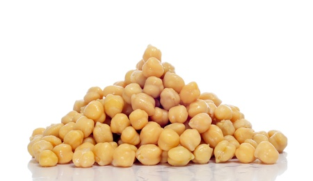 garbanzo bean: closeup of a pile of boiled chickpeas on a white background Stock Photo
