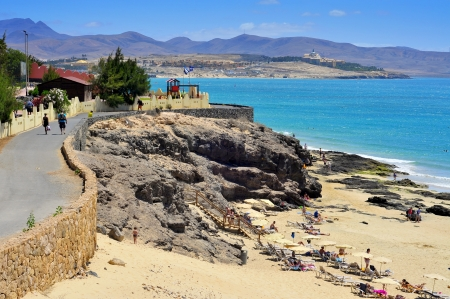 Fuerteventura, Spain - June 22, 2012: Esmeralda Beach in Fuerteventura, Canary Islands, Spain. This white sand beach with turquoise water is named after the nearby hotel Playa Esmeralda Stock Photo - 16743344