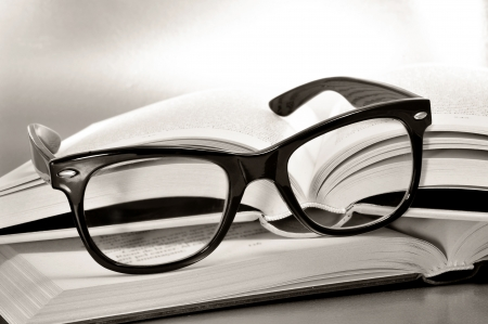 swot: a pile of books and glasses symbolizing the concept of reading habit or studying Stock Photo