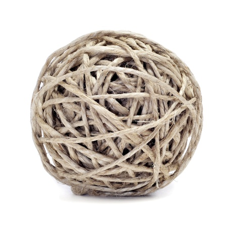 twined: closeup of a ball of hemp twine on a white background