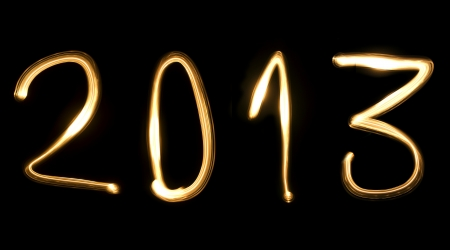 number 2013, as the new year, written with light beam on a black background Stock Photo - 16609104