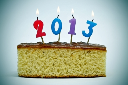 number-shaped candles of different colors forming number 2013, as the new year, on a cake photo