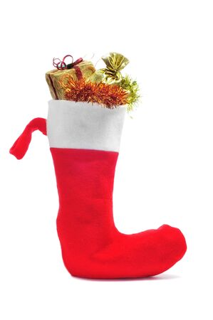 papa noel: santa claus sock full of gifts on a white background