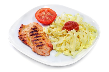 a combo platter with tagliatelle with tomato sauce and grilled chicken on a white background Stock Photo - 16685662