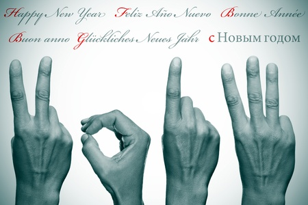 0 1 years: happy new year written in different languages with hands forming number 2013