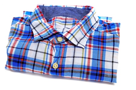 a folded plaid patterned shirt on a white background Stock Photo - 16823570
