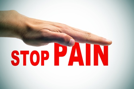 reiki symbol: a man hand above the sentence stop pain written in red