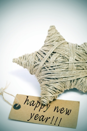 a christmas star made with hemp twine and the sentence happy new year written on a brown paper label Stock Photo - 16857957