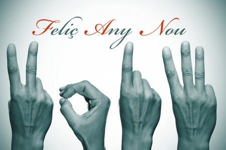 0 1 years: felic any nou, happy new year written in catalan, with hands forming number 2013