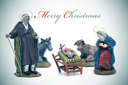 frase Feliz Navidad y la escena de la natividad photo