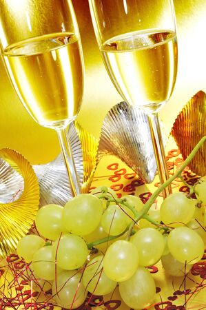 cava: some glasses with spanish cava and a bunch of the grapes of luck, traditional on the New Year
