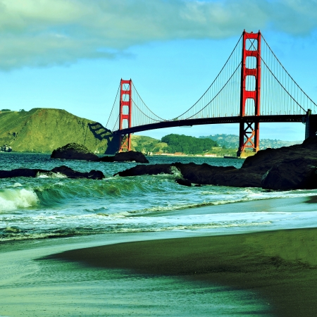 A view of Golden Gate Bridge from Baker Beach in San Francisco, United States, with a retro effect photo