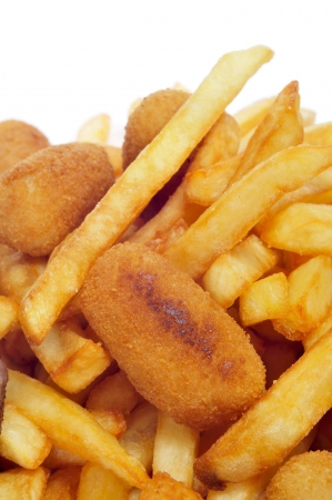 croquettes: closeup of a spanish combo platter with croquettes, calamares and french fries