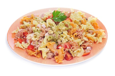 pasta salad: closeup of a plate with refreshing pasta salad on a white background Stock Photo
