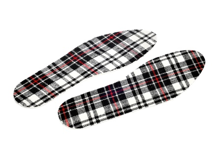 a pair of plaid patterned insoles on a white background Stock Photo - 17047502