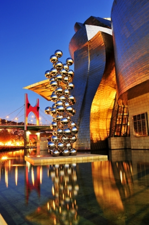 Bilbao, Spain - November 14, 2012: Guggenheim Museum at night in Bilbao, Spain. The picturesque museum was designed by Frank Ghery