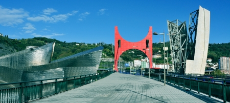 Bilbao, Spain - November 16, 2012: Panoramic view of Guggenheim Museum and Principes de Espana Bridge in Bilbao, Spain. The museum was designed by Frank Ghery