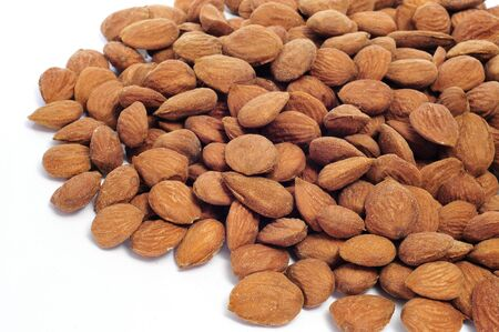 a pile of shelled almonds on a white background photo
